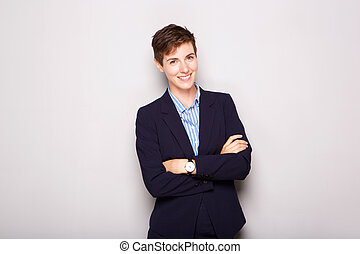 young business woman smiling against white background