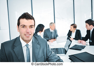 Portrait of young businessman in the office