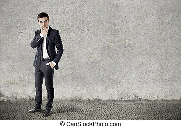 portrait of young businessman on grunge background