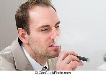 Businessman Smoking Electronic Cigarette