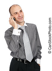 Portrait of young businessman talking on mobile phone