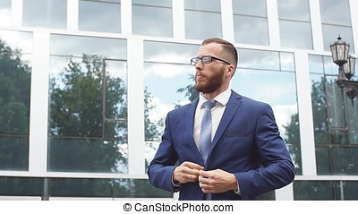 Portrait of young businessman wearing glasses. Slow motion