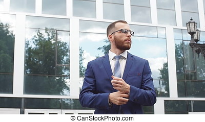 Portrait of young businessman wearing glasses.