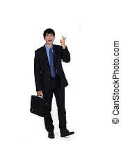 portrait of young businessman with dreamy gaze pointing upwards