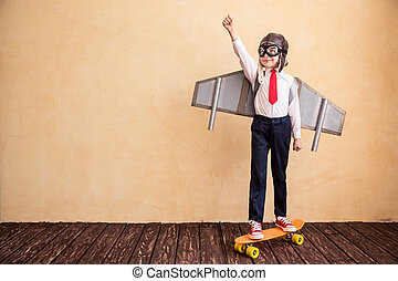 Success - Portrait of young businessman with toy paper wings...