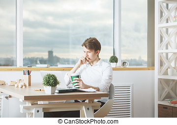 Portrait of young businessperson in office