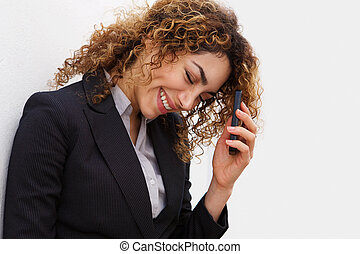 young businesswoman smiling with cellphone