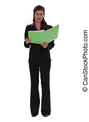 portrait of young businesswoman standing files in hand