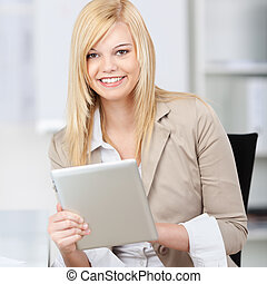portrait of young businesswoman using tablet