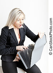portrait of young businesswoman with folders