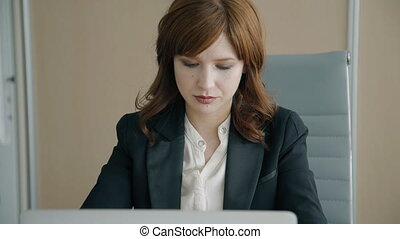Portrait of young businesswoman working in her office.