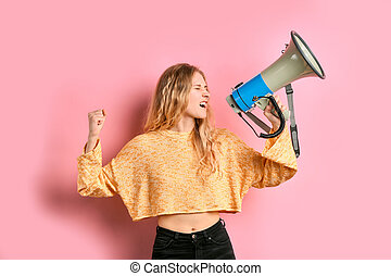 portrait of young caucasian girl with loud speaker