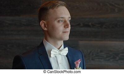 Portrait of young caucasian man in suit