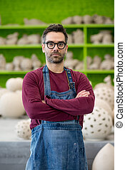 Portrait of Young Ceramist in the Modern Ceramic Workshop. Small Business Concept.