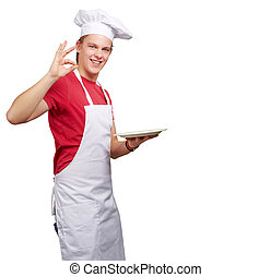 portrait of young cook man against a white background