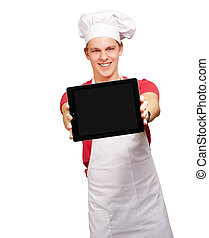 portrait of young cook man showing a digital tablet over white background