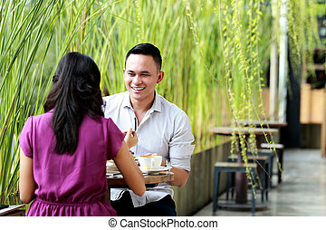 young couple having lunch together