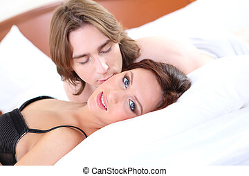 portrait of  young couple in bed