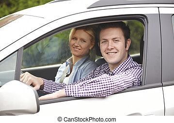 Portrait Of Young Couple Looking Out Of Car Window