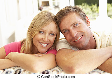 Portrait Of Young Couple Relaxing Together On Sofa