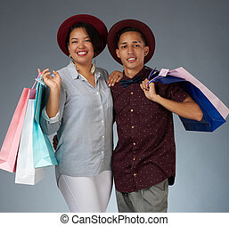 Portrait of young couple with shopping bags