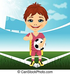 young cute boy with soccer ball standing in stadium