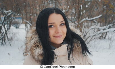 Portrait of Young cute woman in winter park