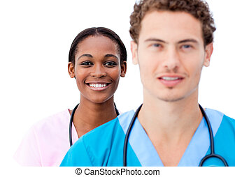Portrait of young doctors standing in a row
