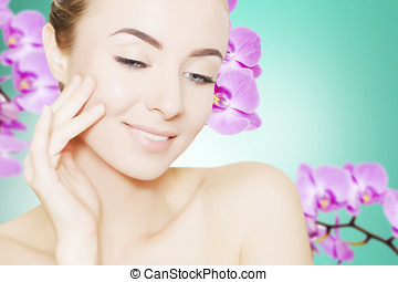 portrait of young european woman with clear skin and purple...
