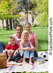 Portrait of young family in a park