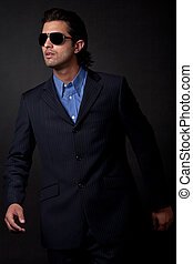 portrait of young fashion model wearing sunglasses