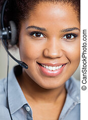 Portrait Of Young Female Customer Service Agent Wearing Headset