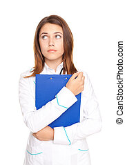 Portrait of young female doctor holding clipboard isolated on white background