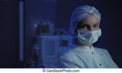 Portrait of Young Female Doctor in Medical Mask. Coronavirus stop.
