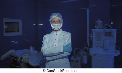 Portrait of Young Female Doctor in Medical Mask Looking at Camera