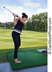 portrait of young female golf player