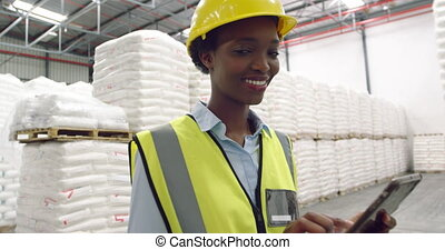 Portrait of young female manager in a warehouse