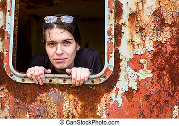 Portrait of young female to abandoned industrial space.