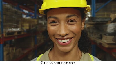 Portrait of young female worker in a warehouse - Head shot ...