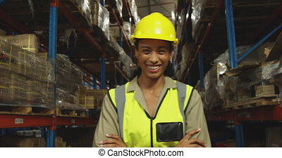 Portrait of young female worker in a warehouse