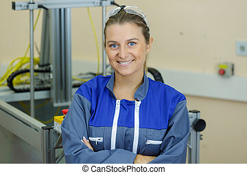 portrait of young female worker with arms crossed