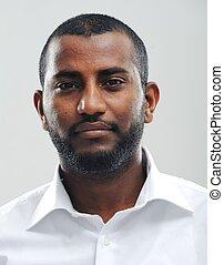 Portrait of young fine black man