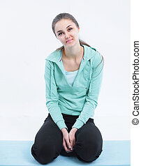 portrait of young fitness woman. isolated on a white background