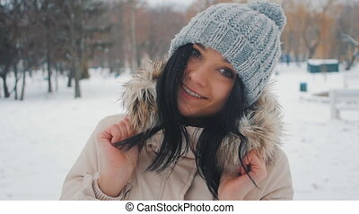 Portrait of Young funny woman in winter park