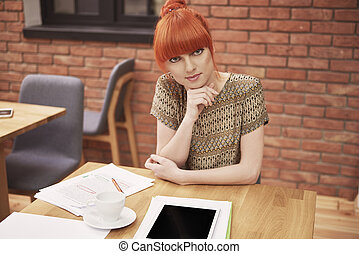 Portrait of young ginger business woman