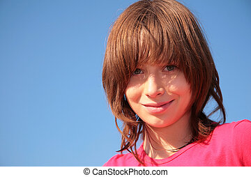 Portrait of young girl on blue sky background