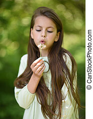 portrait of young girl outdoors in summer