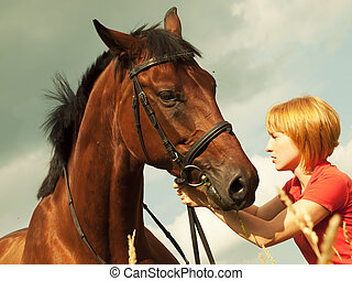 portrait of young girl with horse