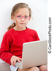Portrait of young girl with laptop.