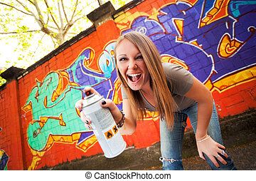 graffiti - portrait of young graffiti artist holding spray...